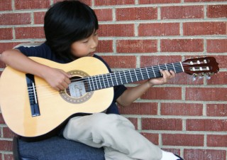 Learn and Boost Your Skills On Guitar In Online Guitar Lessons
